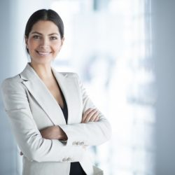 smiling-female-business-leader-with-arms-crossed_1262-3089
